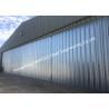 Stable Triangular Seal Vertical Hinged Door Sectional Leaves Folding Sliding Hangar Doors for sale