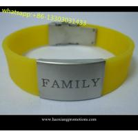 Custom logo double sided silicone wristband With laser engraving metal for sale