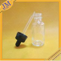 China 1oz clear Boston round glass bottle with black childproof cap on sale