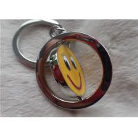 Color Silver Key Chain Personalized Promotional Gifts With Rotatable Smiling Yellow Face for sale