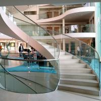 Wholesale Wood Step Glass Rails Curved Staircase with Stainless Steel Stringer and Glass Railing from china suppliers