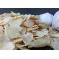 China Wholesale Reduce Blood Pressure Dehydrated pure yellow Garlic Flakes Dehydrated Vegetable 20kg per bag on sale