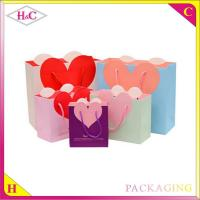Wholesale Heart-Shaped hand length handle paperboard wedding gift bag from china suppliers