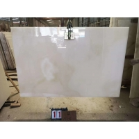 Buy cheap Snow white onyx translucent white onyx marble with red veins wholesale from wholesalers