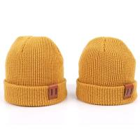 Buy cheap Leather Patch Knit Beanie Hats Custom Design Warm Hat Cap Yellow Beanie Hats from wholesalers