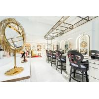 Wholesale Luxury fashion Makeup store interior fit outs by wooden Ivory counters with Bronzed metal craft display Showcase from china suppliers
