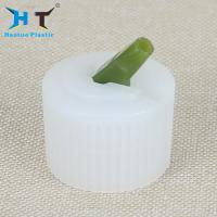 China 20mm 24mm 28mm White Ribbed Plastic Turret Bottle End Cap Cover for sale