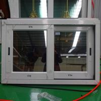 China Tempered clear glass vertical sliding window on sale