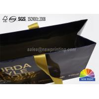 China Glossy Laminated Full Color Printed Custom Paper Garment Bags with Ribbon Handle on sale