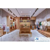 Wholesale Kids cloth store of interior design display furniture by wood color display cabinets and counters with leisure sofa chai from china suppliers